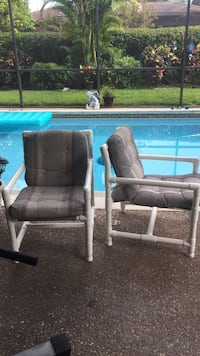 2 PVC patio chairs with cushions