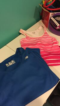 pink and white striped Champion tank top and blue New Balance shirt London, 40740