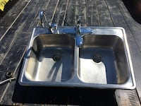 Double kitchen sink comes with sprayer and extra hot water faucet, and all hardware Lethbridge, T1H 0R3