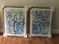 Two brown wooden framed painting of flowers Asheville