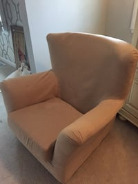 Armchair with beige slipcover