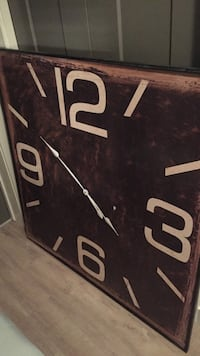 square black and white wooden analog wall clock