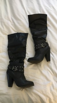 Pair of women's black leather knee-high chunky heel boots Halifax, B3M 3N2