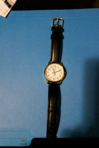 round gold analog watch with black leather strap Montréal, H4L 3K8