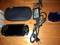 PSP with case and charging cord.  Games included Rockville, 20850