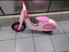 white and pink kick scooter