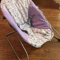 Cosco baby bouncy chair. Safety straps intact. Purple w/flowers.  Waycross, 31503