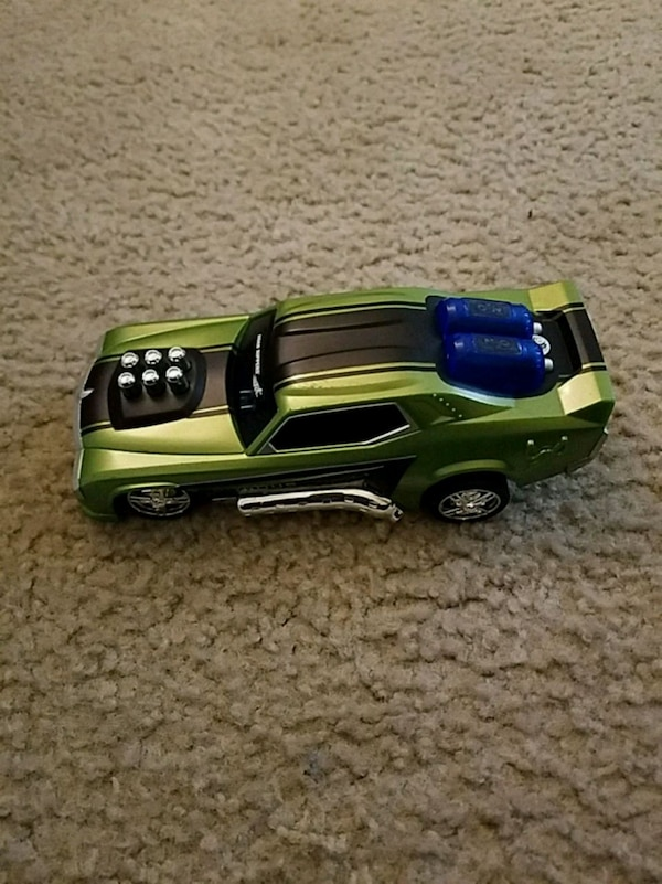 green and black car die cast