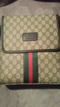 brown and green Gucci backpack Ottawa, K1V 1C1