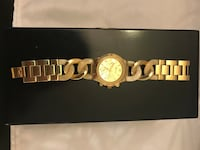 Round gold analog Geneva watch Kelowna, V1V 2T7