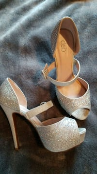pair of silver open-toe ankle strap heels Circleville, 43113