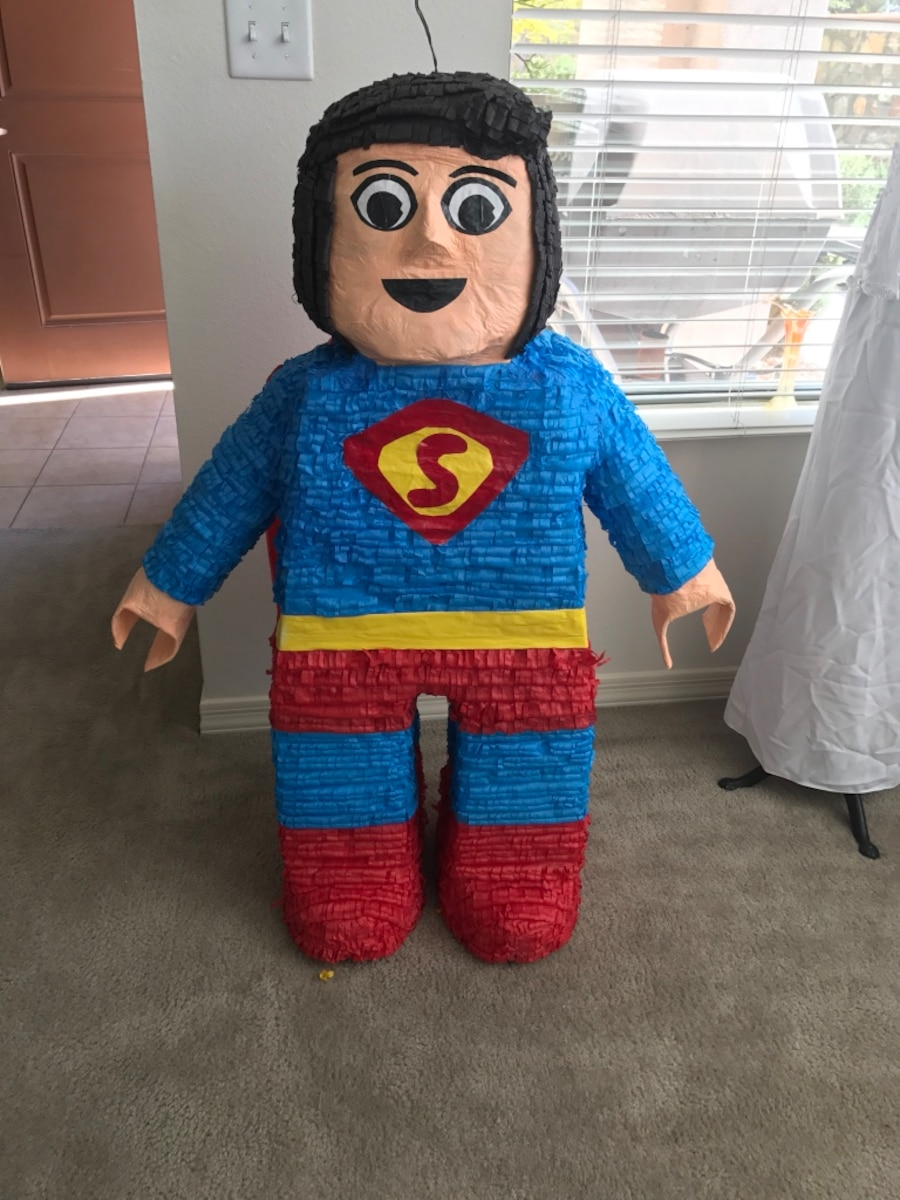 blue and red superman pinata