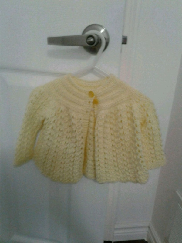 Beautiful, hand-knit cardigan for baby