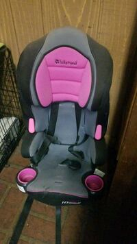 baby's black and pink Evenflo car seat