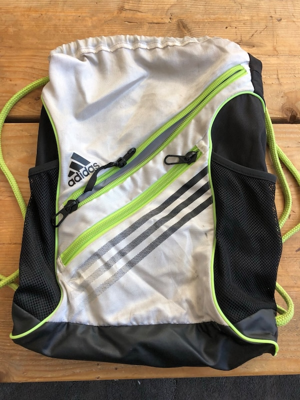 15e6e9305ed39b sling backpack nike Source · Used Assorted Adidas and Nike sling backpacks  with pockets for sale
