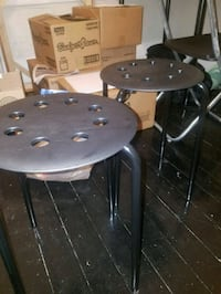 two round black metal stools