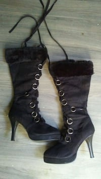 pair of black leather heeled boots Regina, S4T 2H3