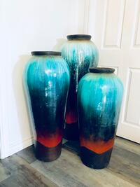 three blue-and-teal ceramic jars Burlington, L7L 6X3