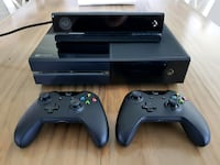 black Xbox One with two controllers null