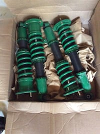 Four green-and-black shock absorbers in box Gambrills, 21054