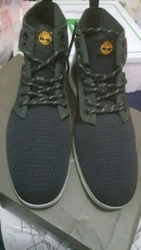 pair of black low top sneakers Toronto, M1E 3W9
