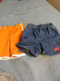 toddler's two orange and blue shorts