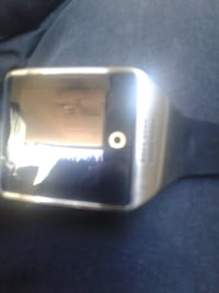gold smartwatch with black band Washington, 20020