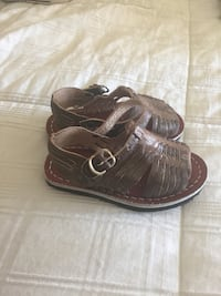 toddler's pair of brown leather sandals