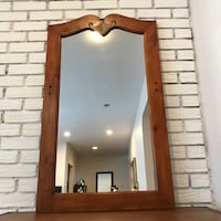 brown wooden framed wall mirror Mont-Royal, H3R 1C3