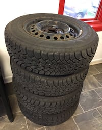 ALMOST BRAND NEW GOODYEAR NORDIC WINTER TIRES AND RIMS