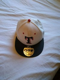 white and black fitted cap Amarillo