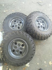 three chrome vehicle wheels with tires