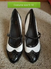 women's pair of black-and-white leather maryjane stilettos