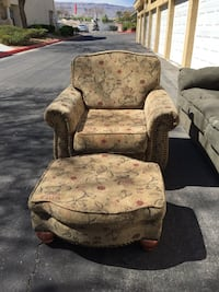 brown and red floral cushioned armchair with square ottoman