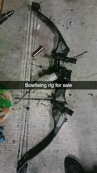black compound bow with text overlay