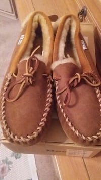 Pair of brown leather boat shoes. Size 7.  Brand new