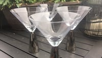 Four clear flute glasses
