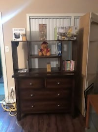 brown wooden dresser with shelves