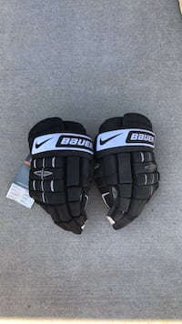 Hockey gloves never been used. Store tag still attached!  Bauer Pros Calgary, T3H 0C4
