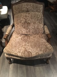 Solid cream and brown chair. Very comfortable No rips or tears Calgary, T3M 1J1