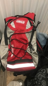 red and beige Coleman backpack