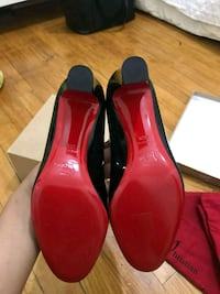 pair of red patent leather heeled shoes Toronto, M8Z