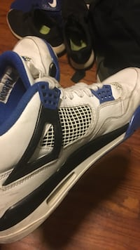 pair of white-and-blue Air Jordan 4 shoes