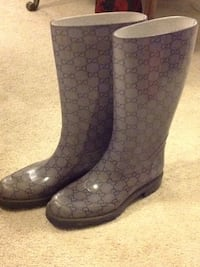 pair of black leather boots Vaughan