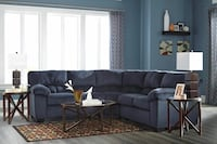 black fabric sectional sofa with throw pillows Roslyn Heights, 11577