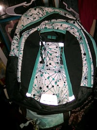 white, black, and teal backpack