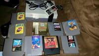gray NES game console, controller and games