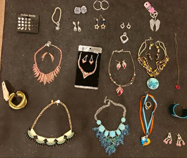 Assorted necklaces, necklace & earrings, & braclet