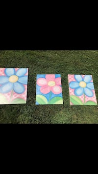 One pink and two blue flower paintings Oakville