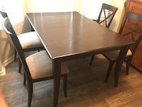 Rectangular brown wooden table with four chairs dining set Lithia Springs